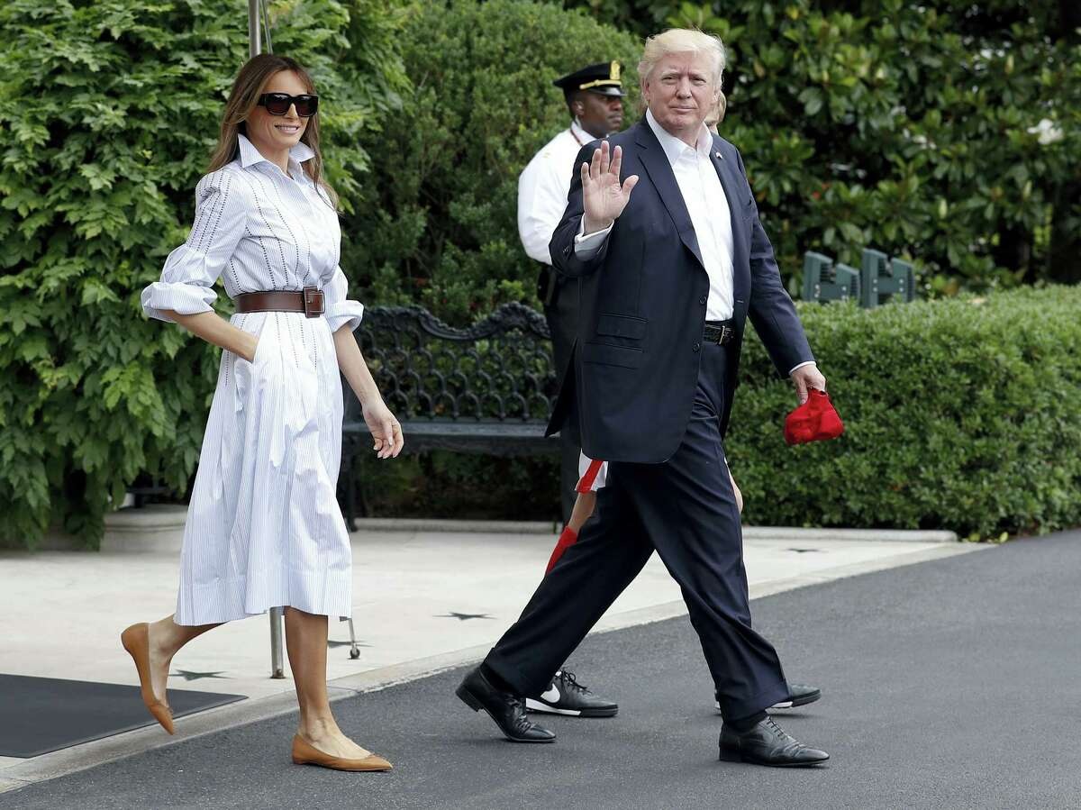 FILE - In this June 17, 2017, file photo, President Donald Trump, first lady Melania Trump, and their son and Barron Trump, walk to board Marine One from the White House in Washington, en route to Camp David in Maryland. Melania Trump ended her estrangement from Washington when she moved to the White House earlier this month and reunited with President Donald Trump after nearly five months apart. So what's next now that she's finally here? The below-the-radar first lady packed quite a bit into her first weeks as a full-timer at the White House, without being overtly public about it.(AP Photo/Carolyn Kaster, File)
