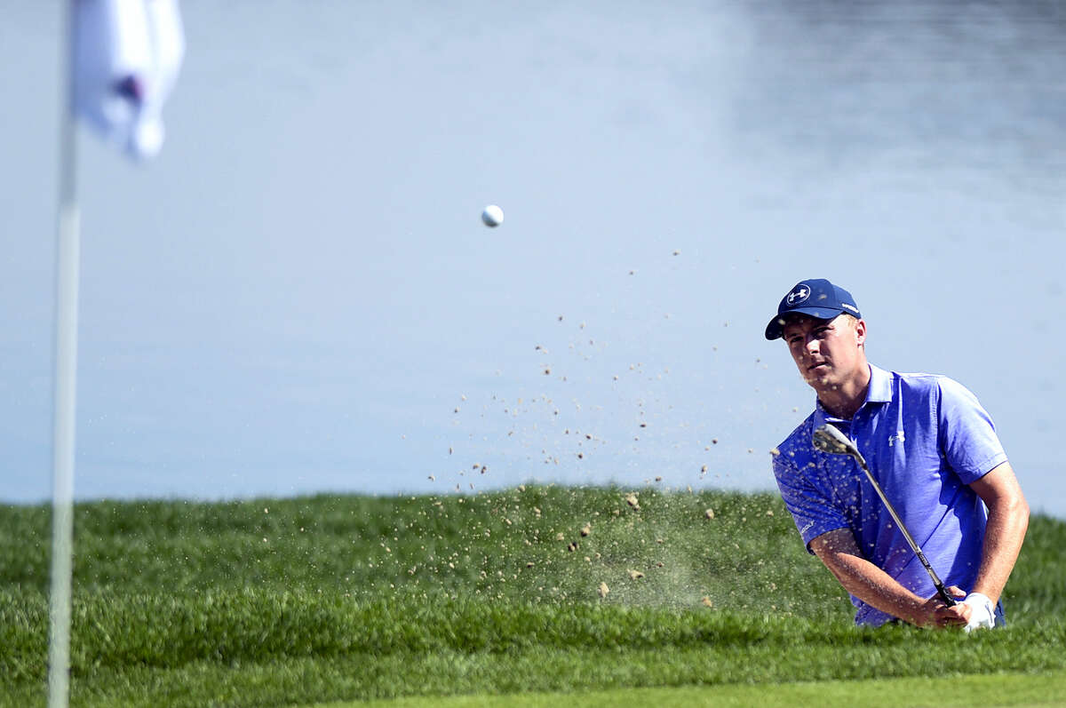 Jordan Spieth blasts out of a bunker on the 16th hole during the second round of the Travelers Championship Friday in Cromwell.