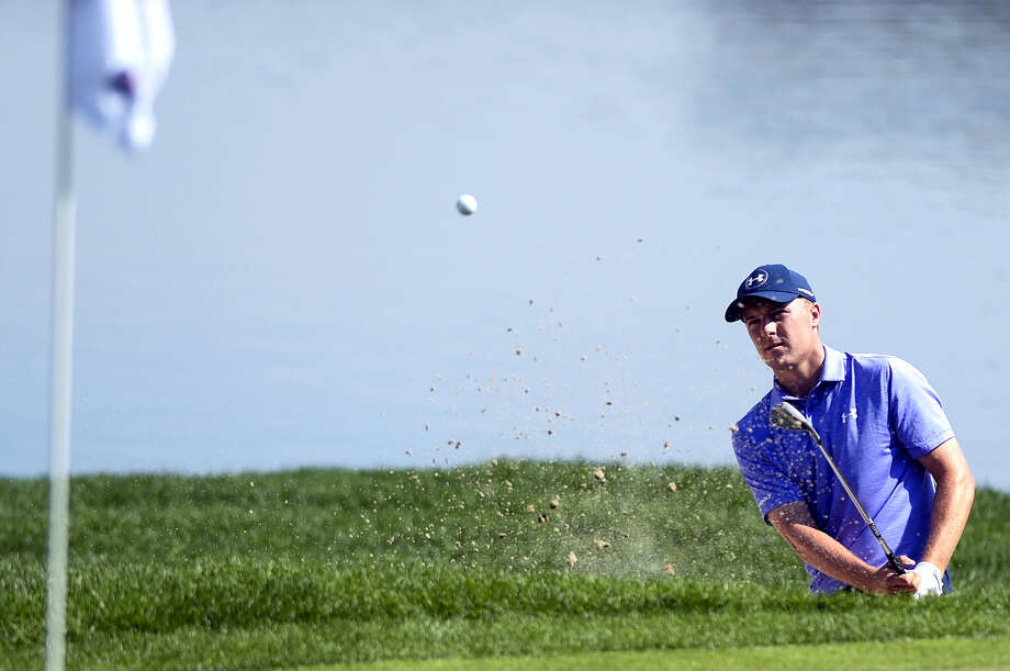 Jordan Spieth blasts out of a bunker on the 16th hole during the second round of the Travelers Championship Friday in Cromwell. Photo: Patrick Raycraft — Hartford Courant Via AP  / Hartford Courant