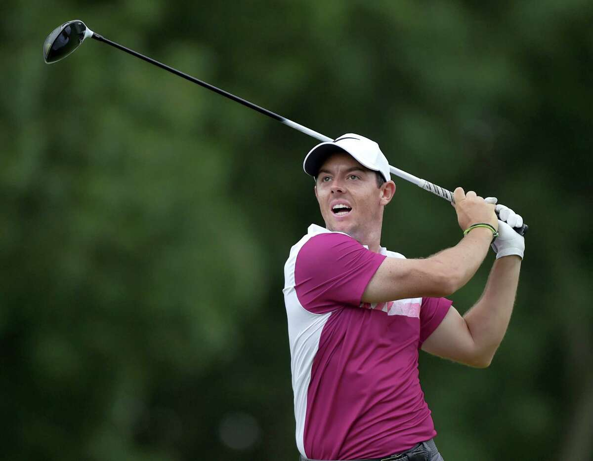 Rory McIlroy reacts after his tee shot on the 18th hole during the second round of the Travelers Championship on Friday.