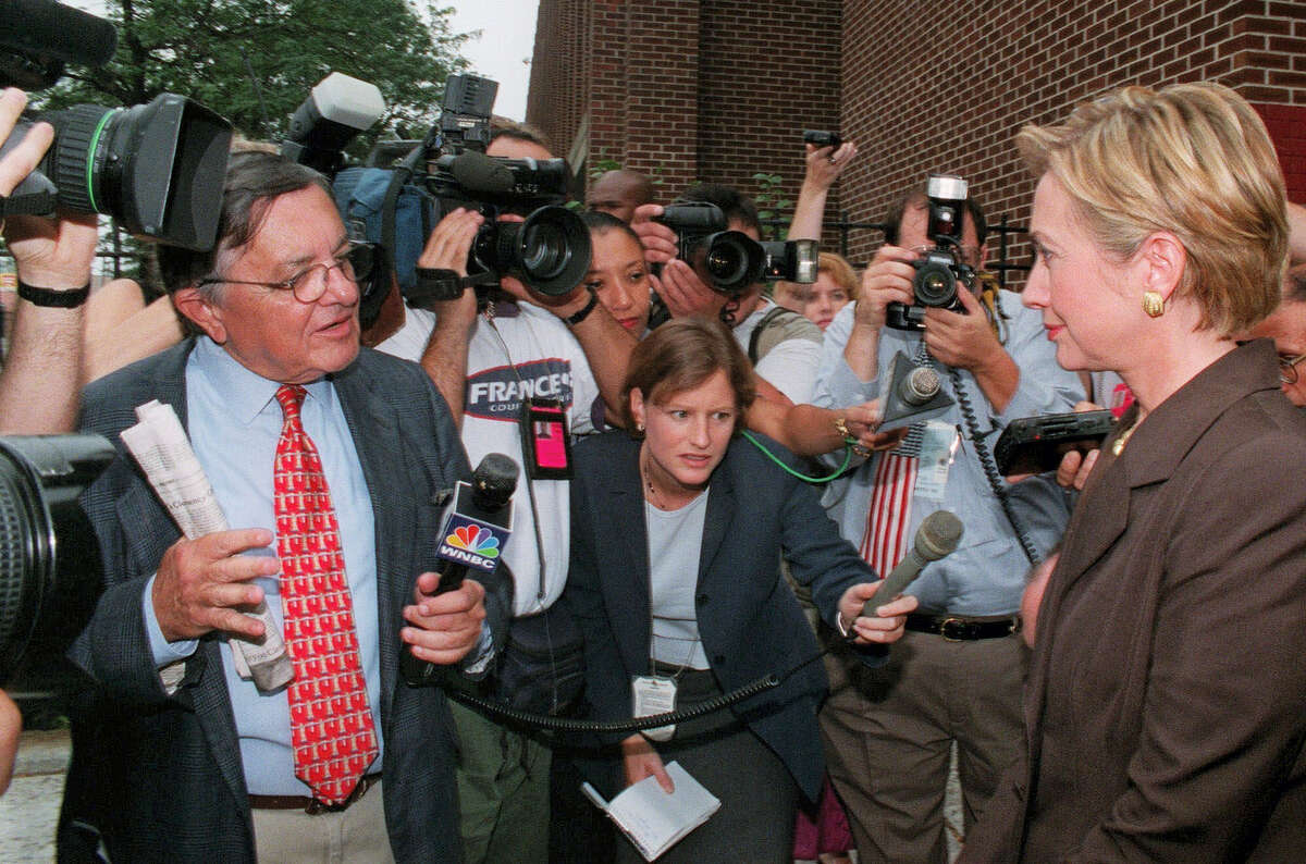 This photo from Thursday, Sept. 9, 1999, shows WNBC television reporter Gabe Pressman as he questions First Lady Hillary Rodham Clinton, during her visit to Queens borough of New York. Pressman, an intrepid, Emmy-winning journalist who still relished going to work at the age of 93, died early Friday, June 23, 2017, at a Manhattan hospital.