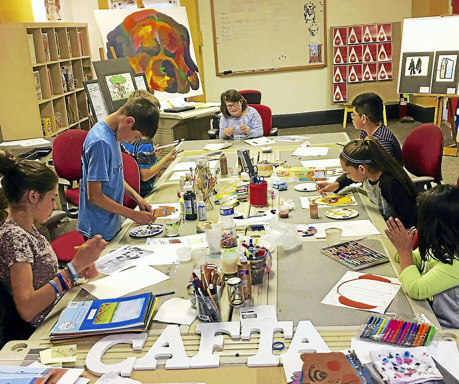 CAFTA students prepare their work for the fundraiser at Hanq's on Monday. Photo: Contributed Photos / CAFTA