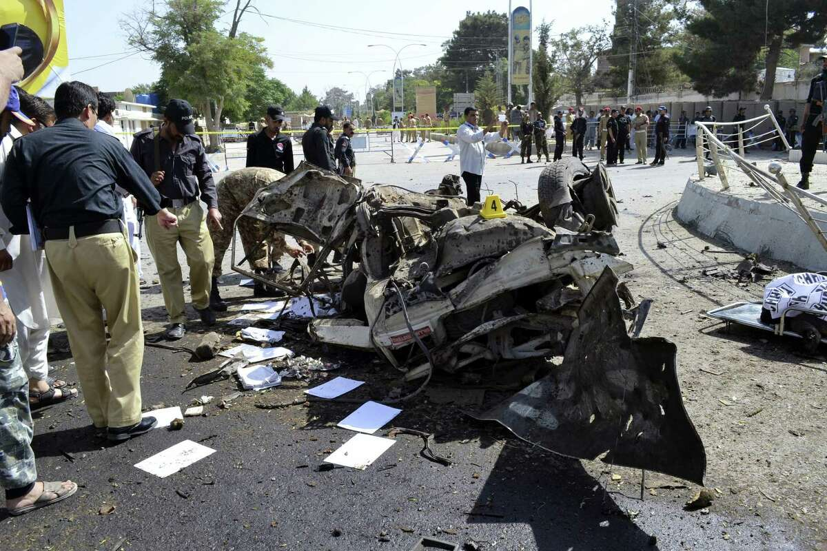 Pakistani police officers examine the site of an explosion in Quetta, Pakistan, Friday, June 23, 2017. A powerful bomb went off near the office of the provincial police chief in southwest Pakistan on Friday, causing casualties, police said.