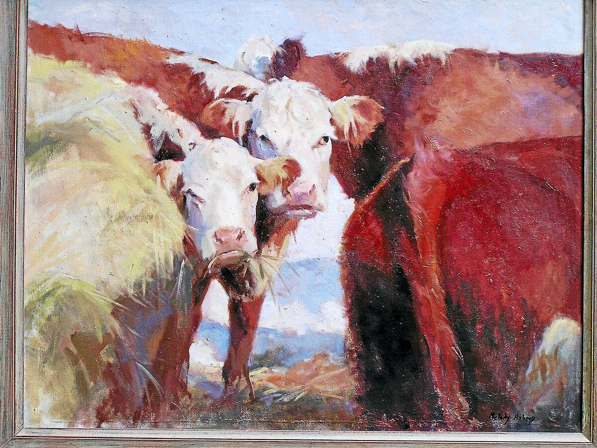 Cows munching on grass is the subject of this animal painting.