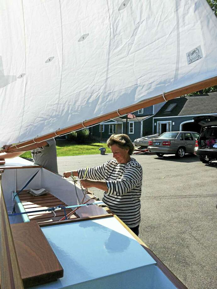 Diane Tucker checks the rigging on her sailboat. Photo: Contributed Photos
