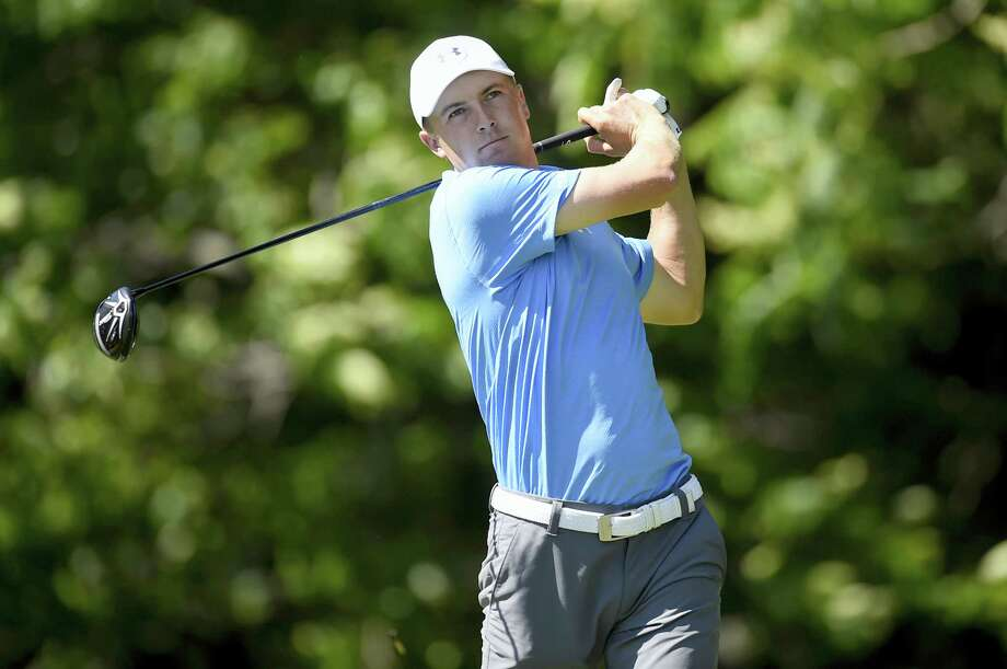 Jordan Spieth watches his tee shot on the 12th hole during the first round of the Travelers Championship Thursday. Photo: John Woike — Hartford Courant Via AP  / Hartford Courant