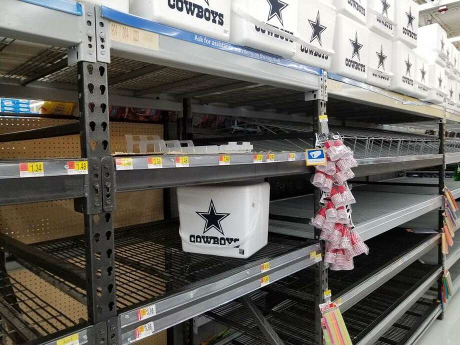 Even a hurricane of Biblical proportions can't turn a Houston man into a Cowboys fan. Swipe through to see the other items people can do without during the storm. Photo: Amjad Ismail