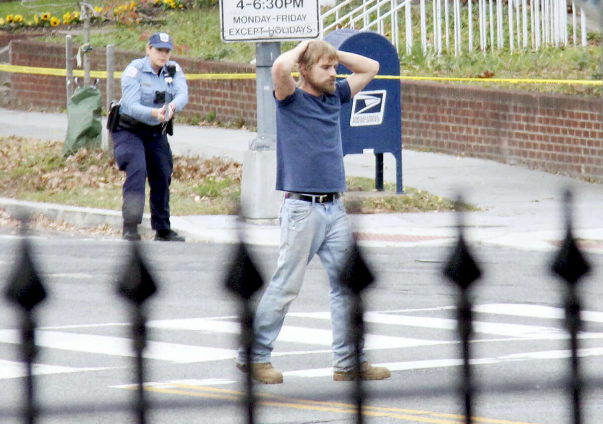 In this Dec. 4, 2016 file photo, Edgar Maddison Welch, of Salisbury, N.C., surrenders to police in Washington. Welch is set to be sentenced Thursday at a hearing in federal court in Washington.