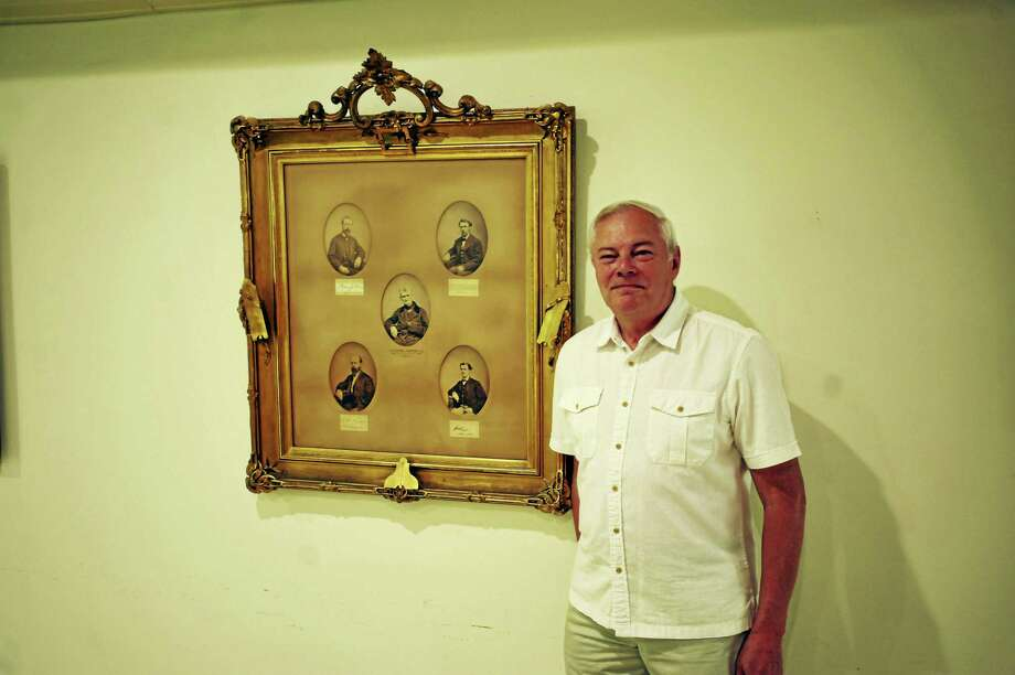 Seneca Lodge 55, recently marked its 200th anniversary in Torrington. Above, Joe Albanese, the junior warden of Seneca Lodge 55, poses with the pictures of the first six masters of the Masonic lodge. Photo: Ben Lambert / Hearst Connecticut Media