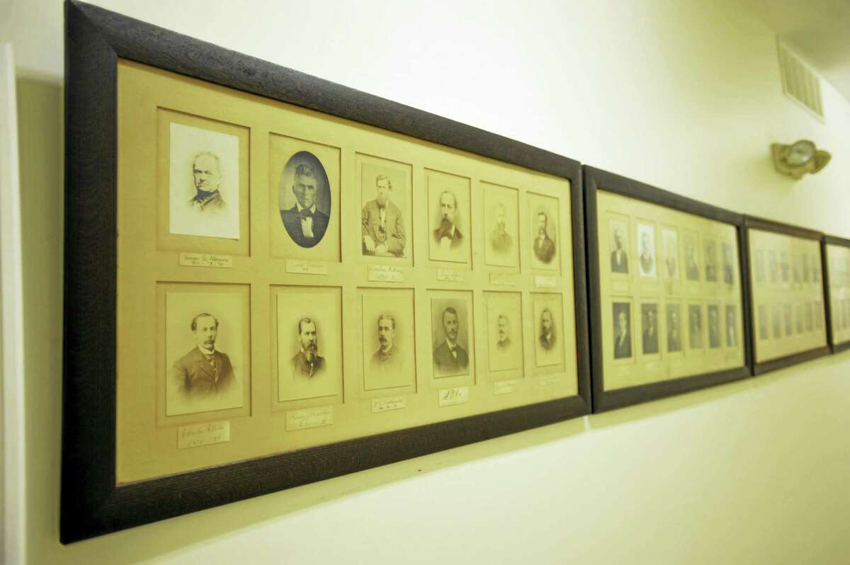 Seneca Lodge 55, a Masonic lodge in the city of Torrington, recently marked its 200th anniversary. Above, past masters of the lodge, dating back through the centuries.