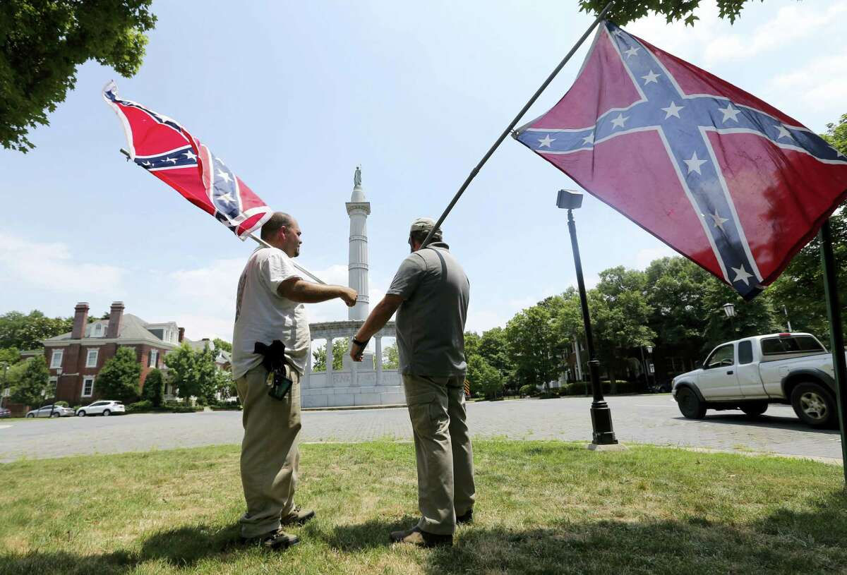 In this June 25, 2015 file photo Virginia flaggers demonstrate near the monument to former Confederate President Jefferson Davis on Monument Avenue in Richmond, Va. Richmond Mayor Levar Stoney announced Thursday, June 22, 2017, the formation of a commission to help redefine the narrative of the statues on the avenue.
