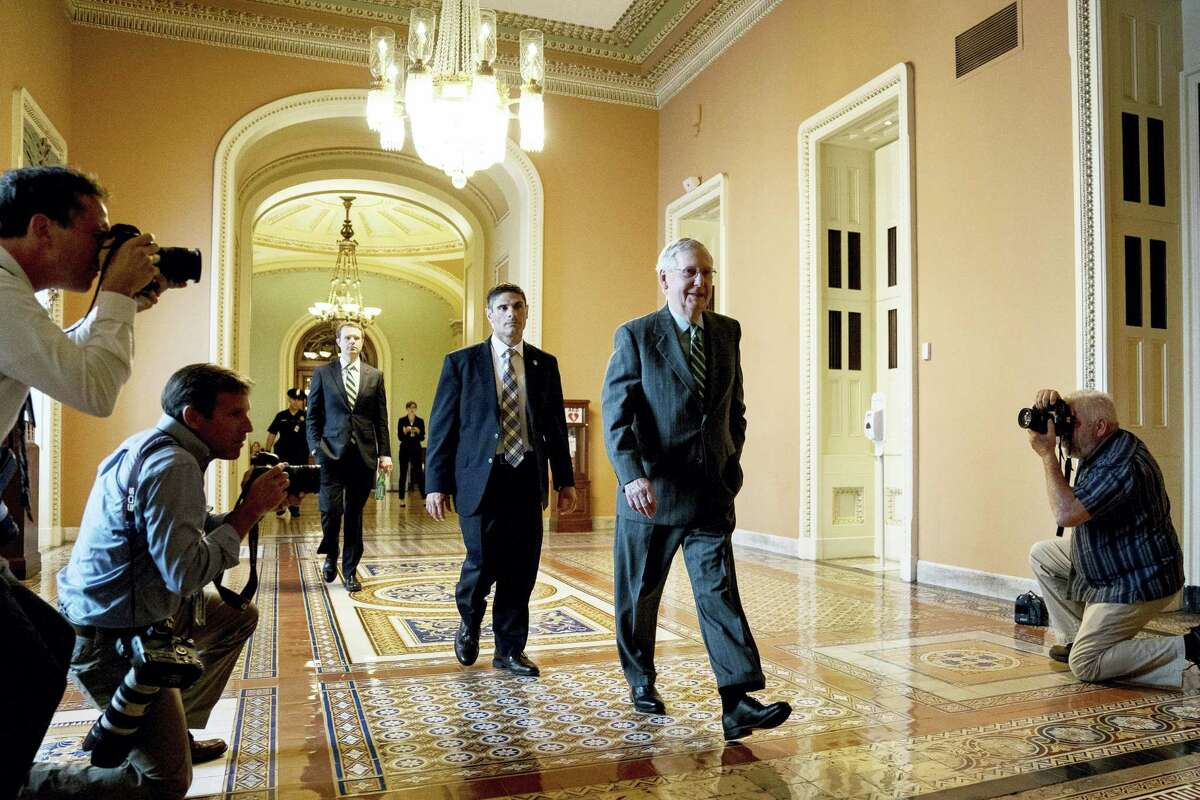 Senate Majority Leader Mitch McConnell of Ky. arrives on Capitol Hill Thursday in Washington.
