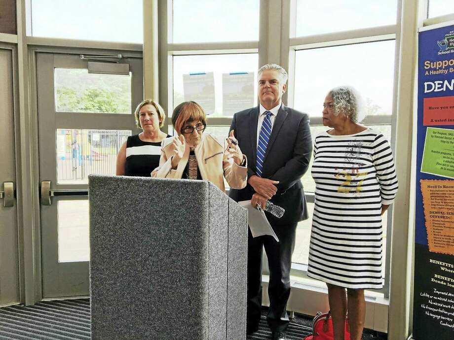 From left, Vanessa Taragowski, director of pupil services at ACES; U.S. Rep. Rosa DeLauro, D-3; Tom Danehy, executive director of ACES and parent Dawn Oduor.  They held a press conference at the Hill Central School to talk about the negative impact of losing Medicaid funding for disabled children. Photo: Mary O'Leary / Hearst Connecticut Media
