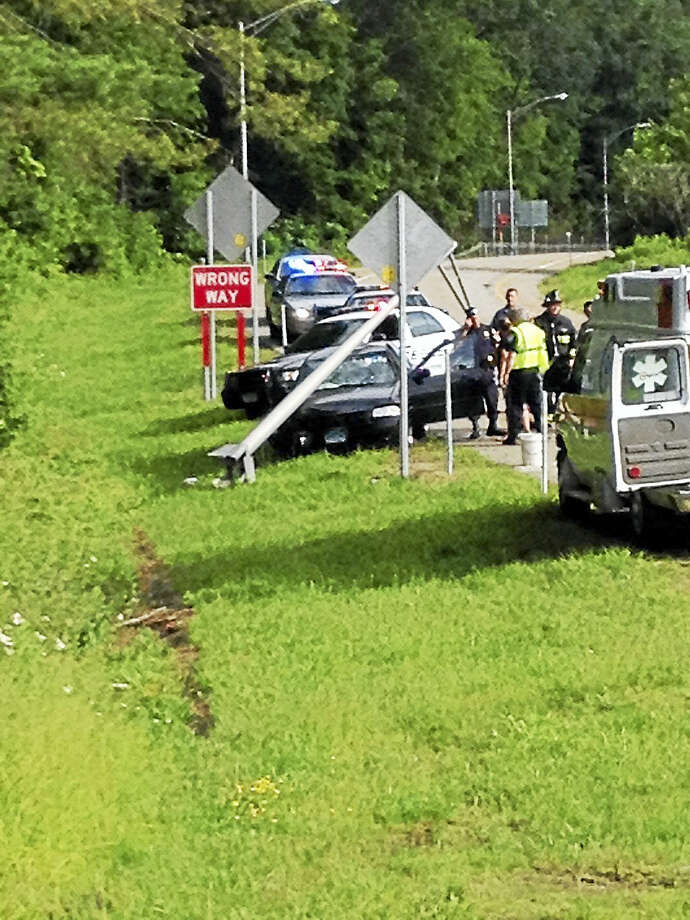 A car crashed into a utility pole on the northbound ramp of exit 43 on Route 8 late Thursday afternoon. Photo: Emily M. Olson / Hearst Connecticut Media
