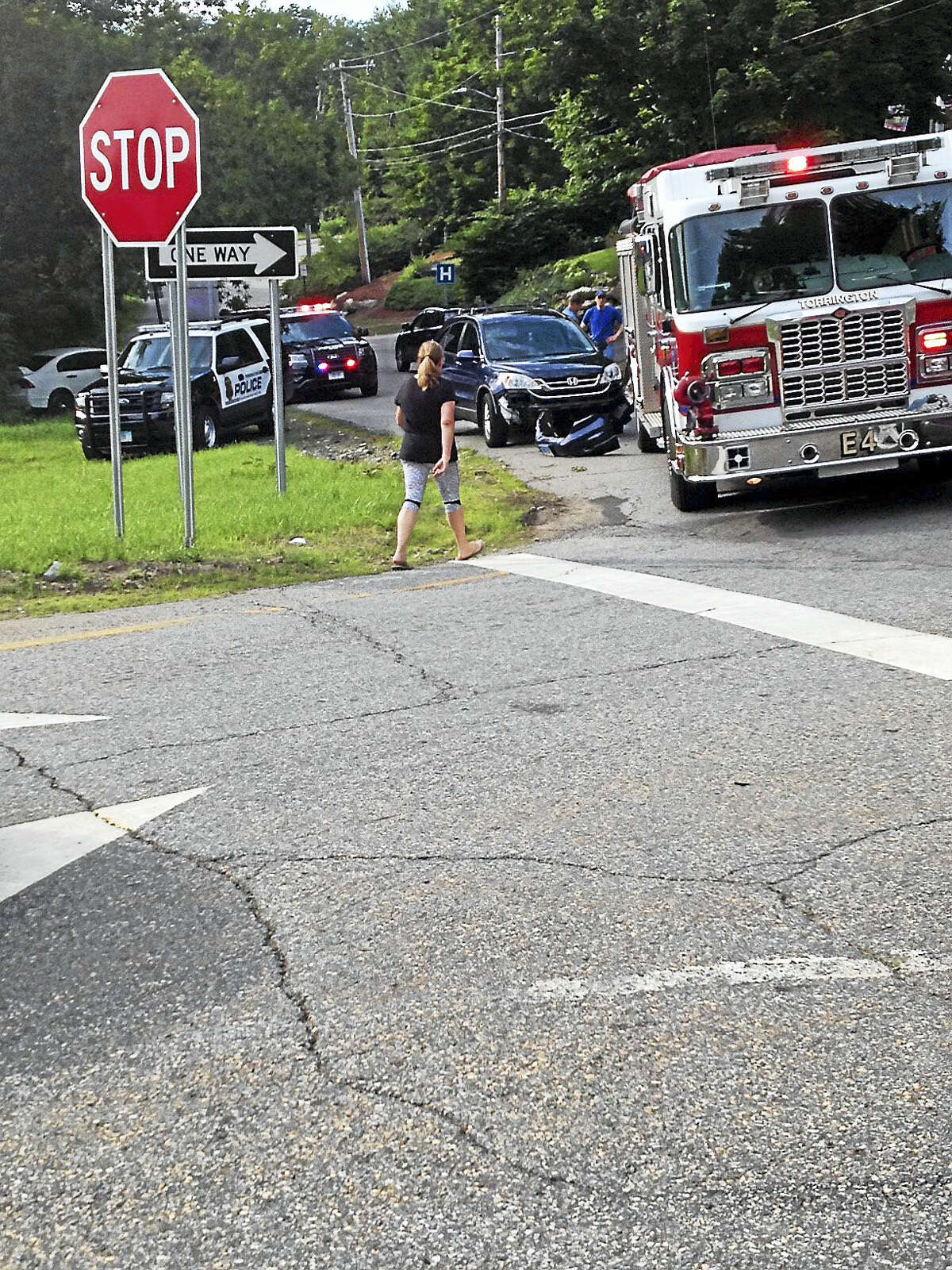 An SUV collided with a Torrington fire truck near the exit ramp of exit 43 on Route 8 Thursday afternoon. The fire truck was on its way to an accident on the exit ramp and allegedly backed into the SUV; the incident is under investigation, according to fire department members.