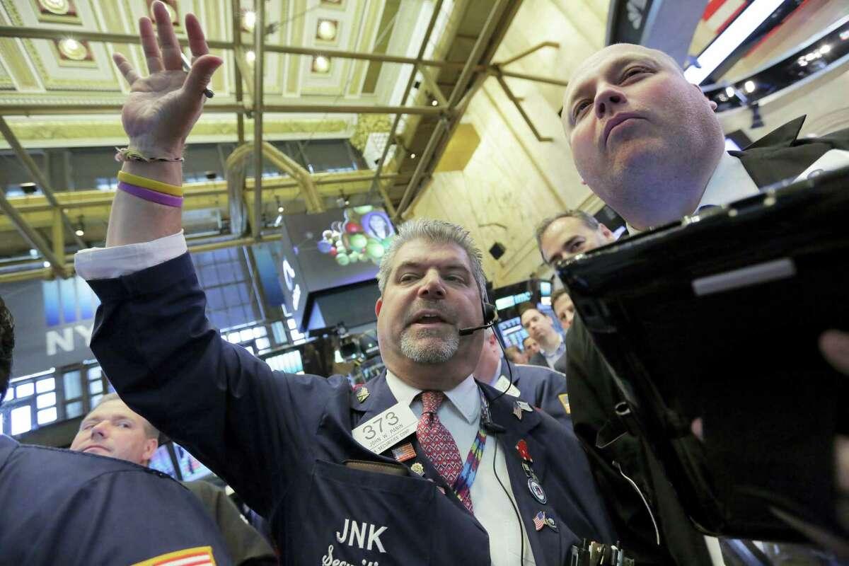 Traders John Panin, left, and Michael Casey work on the floor of the New York Stock Exchange Thursday.