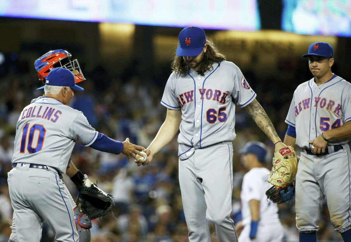 New York Mets starting pitcher Robert Gsellman, center, hands the ball to manager Terry Collins as he is relieved during the fifth inning of a baseball game against the Los Angeles Dodgers on June 20, 2017 in Los Angeles.