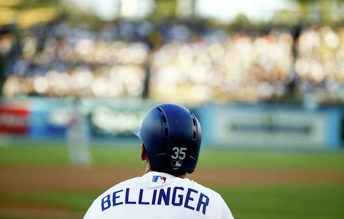 Los Angeles Dodgers' Cody Bellinger watches from the dugout during the first inning of the team's baseball game against the New York Mets on June 20, 2017 in Los Angeles.