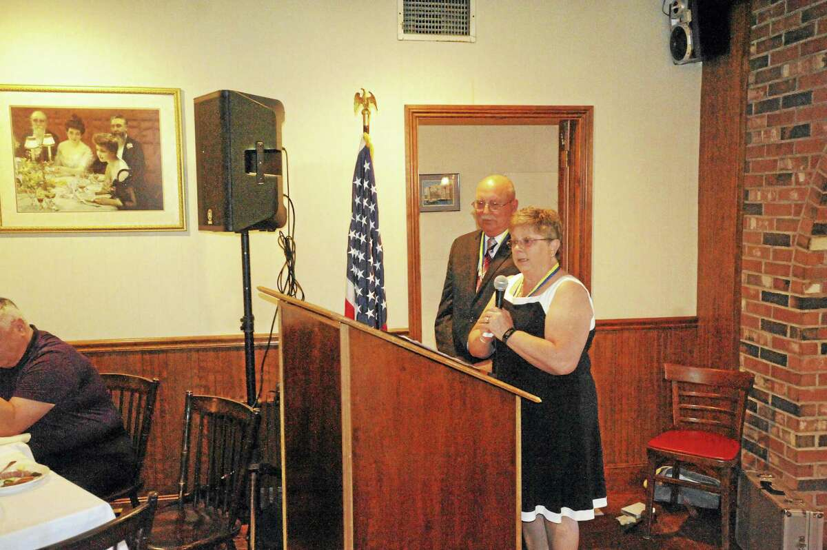 Torrington residents Charlie and Pat Marciano were recognized with the Paul Harris Award by the Torrington-Winsted Area Rotary Club Tuesday. Above, the couple addresses their fellow members and guests during the presentation at Marino's Restaurant in Torrington.