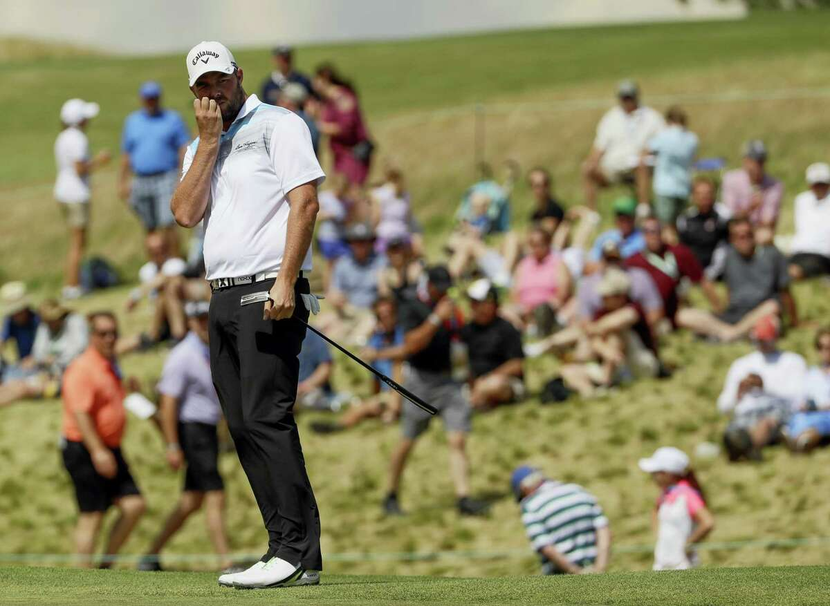 Marc Leishman, of Australia, watches his putt on the ninth hole during the fourth round of the U.S. Open golf tournament Sunday at Erin Hills in Erin, Wis.