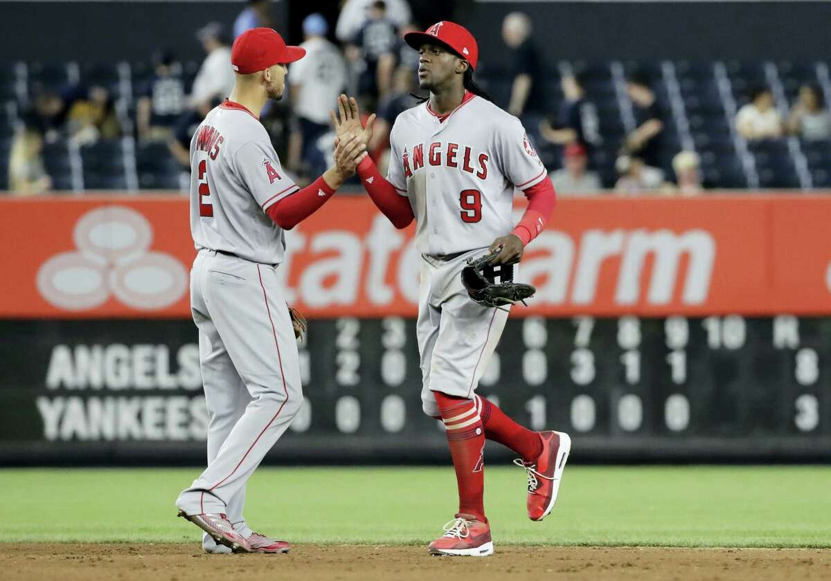 Los Angeles Angels' Cameron Maybin (9) celebrates with Andrelton Simmons (2) after the Angels defeated the New York Yankees 8-3 in a baseball game Tuesday, in New York.