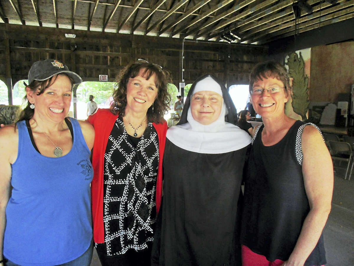 Above, from left, are Anne Doe of Boston Post Dairy, Sally Camm of Clay & Wattles Theater, Mother Noella Marcellino, and Susan Blouin of Boston Post Dairy, at the Farm Art Festival in Bethlehem.