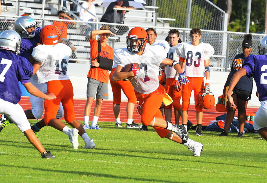 The Bridgeland Bears faced off against the Klein Cain Hurricanes Friday Aug. 18 in Klein, the first time either fledgling program took the field against an opponent. The two will continue to see plenty of one another as they try to carve out a place for themselves in the top echelon of Houston high school football. Bridgeland head coach David Raffield and Klein Cain head coach James Clancy are leaning into the natural bond between the two programs, hoping the Bears and Hurricanes can help propel one another to greatness. Photo: Tony Gaines / HCN