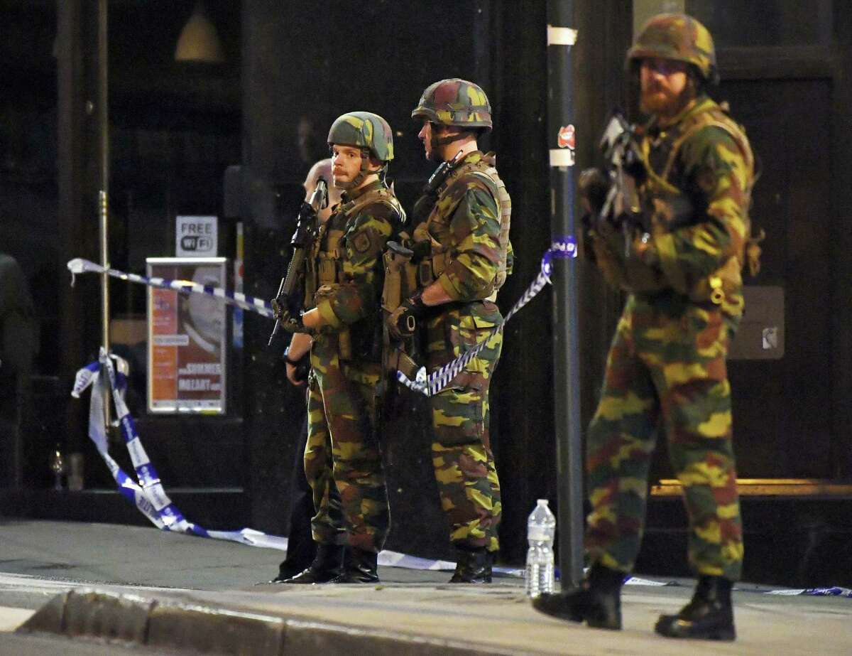 Belgian Army soldiers patrol in front of Central Station in Brussels after a reported explosion on Tuesday, June 20, 2017. Belgian media are reporting that explosion-like noises have been heard at a Brussels train station, prompting the evacuation of a main square. (AP Photo/Geert Vanden Wijngaert)