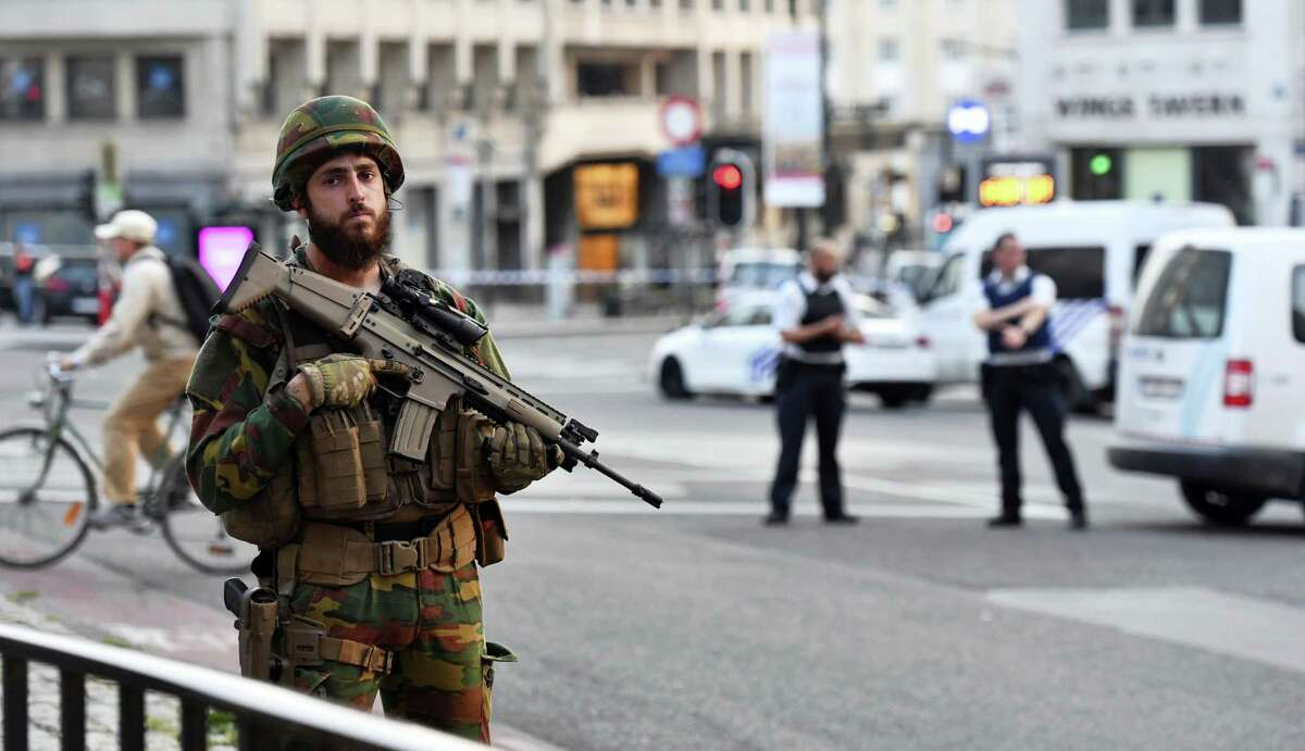 A Belgian Army soldier stands outside Central Station after a reported explosion in Brussels on Tuesday, June 20, 2017. Belgian media are reporting that explosion-like noises have been heard at a Brussels train station, prompting the evacuation of a main square. (AP Photo/Geert Vanden Wijngaert)