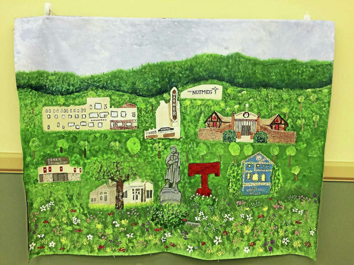 Students with the unified arts program at Torrington High School painted a mural depicting some of the landmarks of the city.