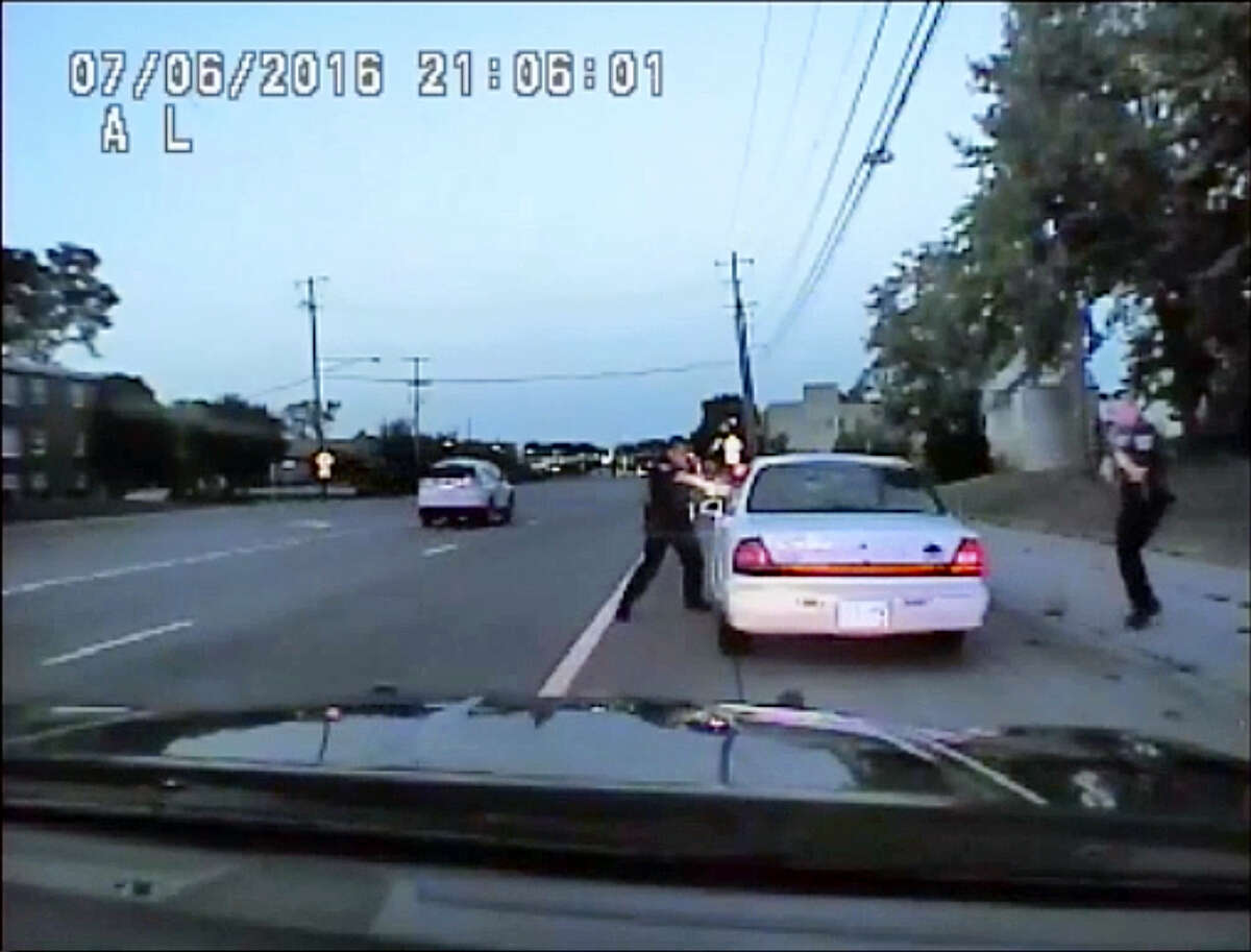 In this image made from July 6, 2016, video captured by a camera in the squad car of St. Anthony Police officer Jeronimo Yanez, the Minnesota police officer shoots at Philando Castile in the vehicle during a traffic stop in Falcon Heights, Minn. Yanez's backup officer Joseph Kauser is seen standing on the passenger side of the vehicle. The video was made public by the Minnesota Bureau of Criminal Apprehension and the Ramsey County Attorney's Office, Tuesday, June 20, 2017, just days after the officer was acquitted on all counts in the case.