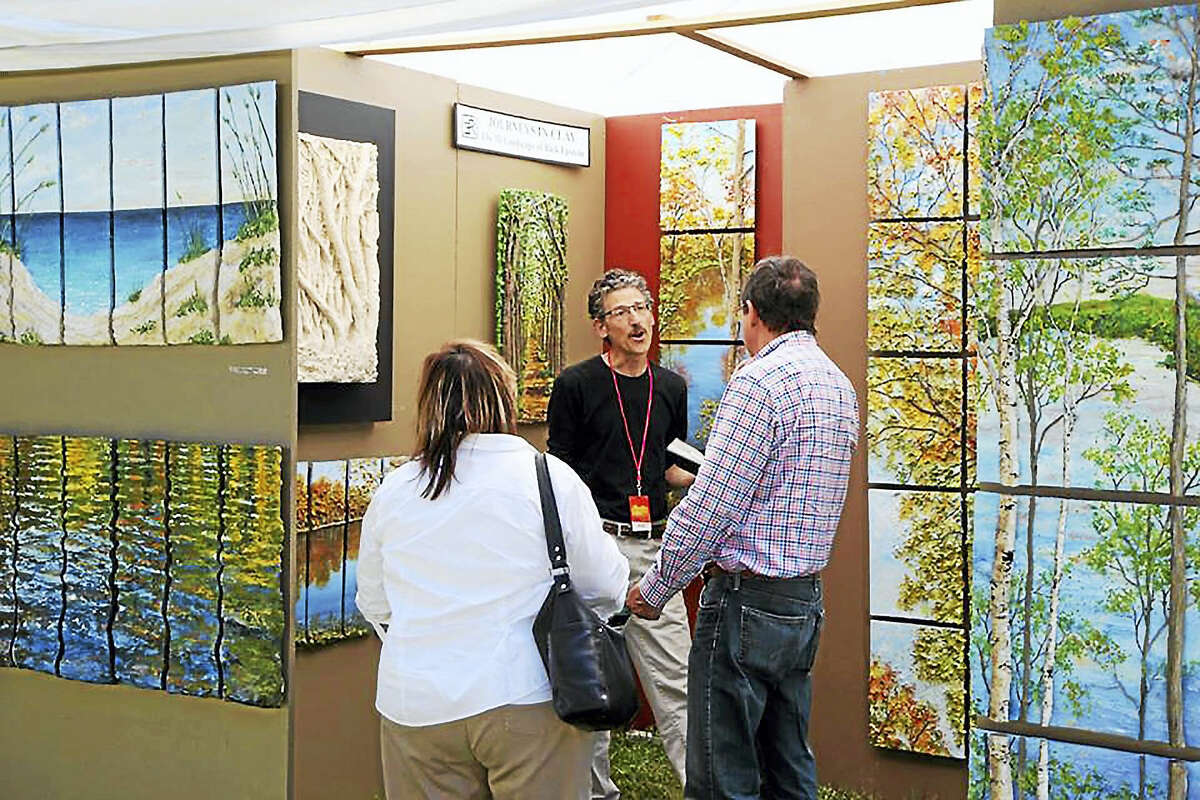 Rick Epstein of Rick Epstein Clayworks, discusses his work with visitors at his studio.