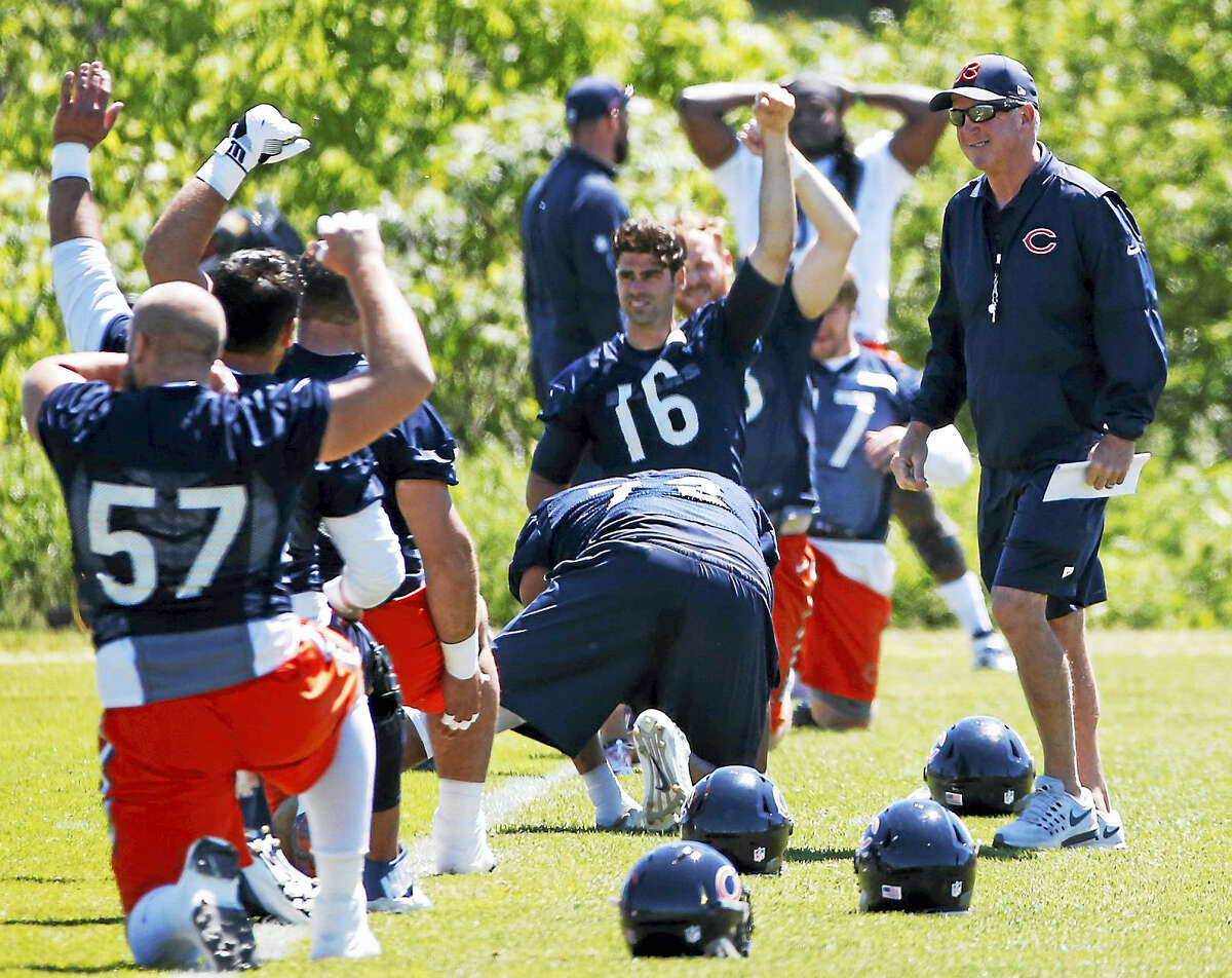 Members of the Chicago Bears run through a practice.