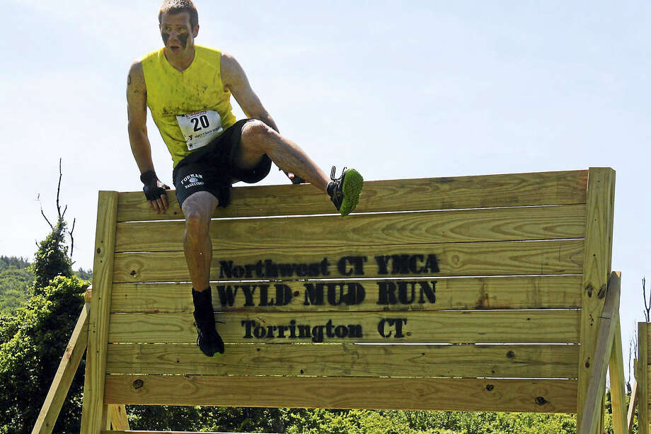 Participants tackle the obstacles in previous years of the WYLD Obstacle Run. This year's run is being held at Camp MOE in Torrington. Photo: Contributed Photos