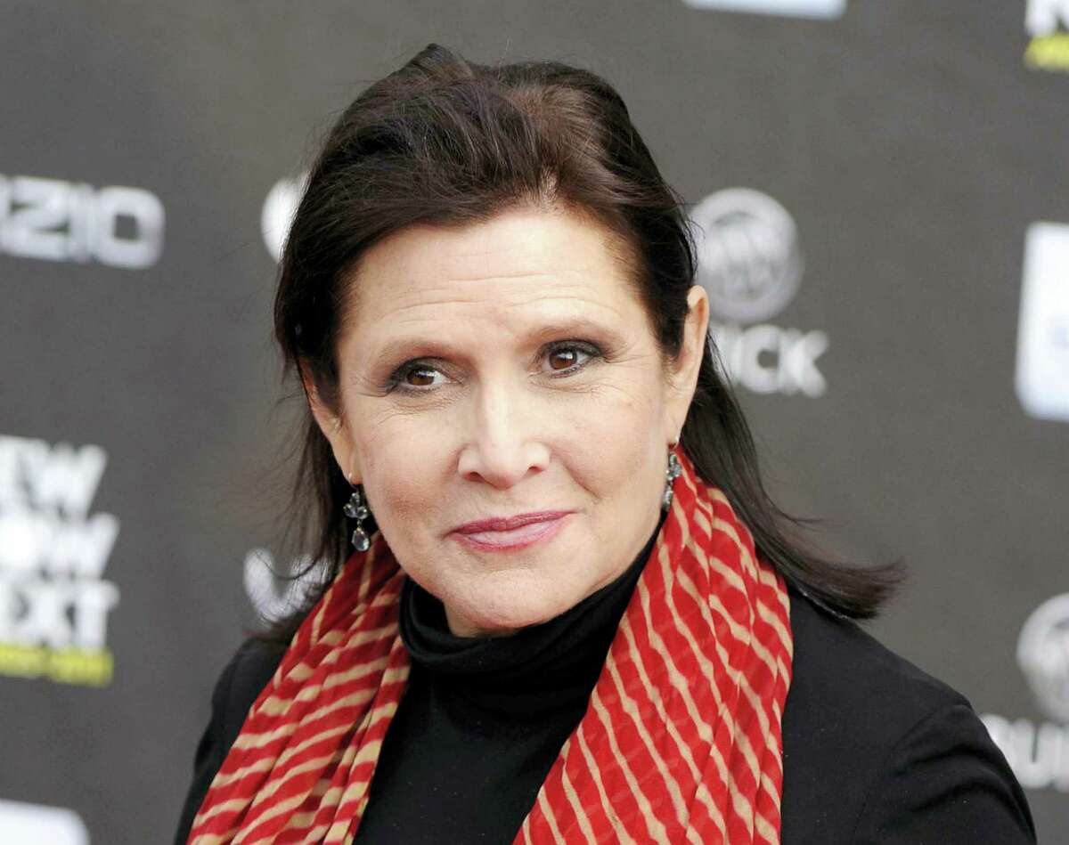 This April 7, 2011, file photo shows Carrie Fisher at the 2011 NewNowNext Awards in Los Angeles. A coroner's report released Monday, June 19, 2017, shows that Fisher had cocaine, ecstasy and heroin in her system when she became ill on a London to Los Angeles flight in December. The reports states it is difficult to pinpoint when the drugs were taken and their impact on Fisher's Dec. 27, 2016 death, which was caused by sleep apnea and other undetermined factors, Fisher's autopsy report states.