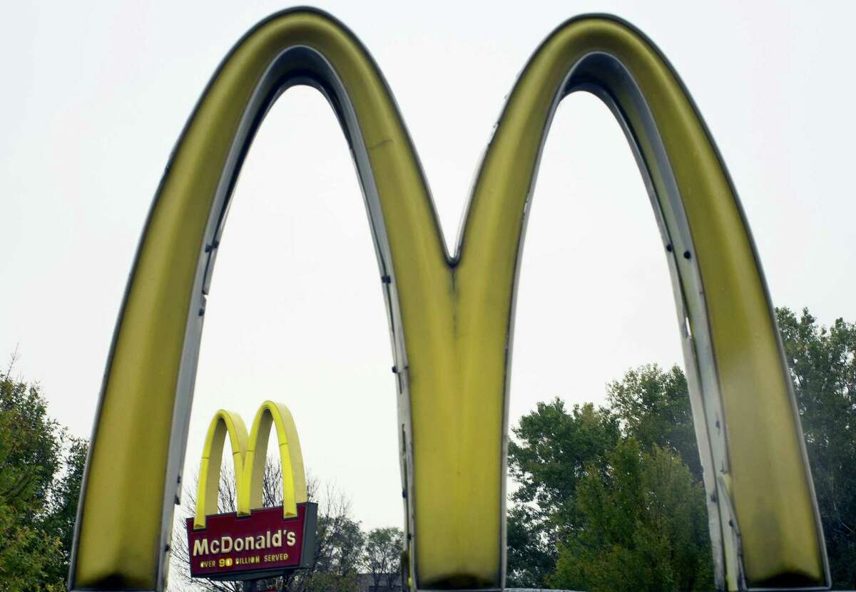 FILE - This Oct. 21, 2011 file photo shows the golden arches of McDonalds, in Omaha, Neb., McDonald's has ended its Olympic sponsorship deal three years early. The International Olympic Committee says confidential financial terms of the immediate separation were agreed to.