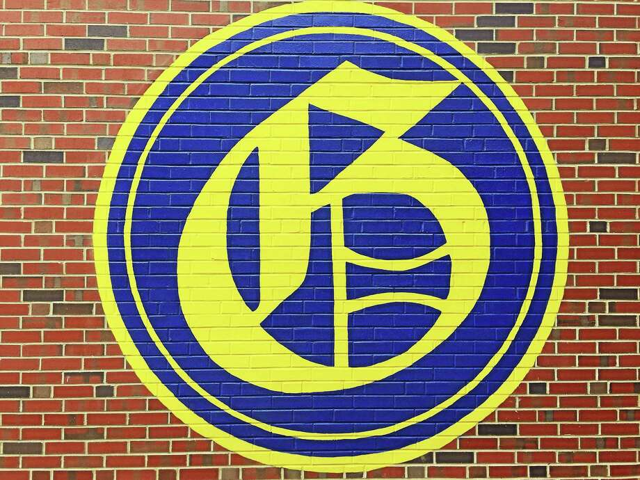 A logo marking The Gilbert School, as seen on the wall outside the institution. Photo: Ben Lambert - Hearst Connecticut Media