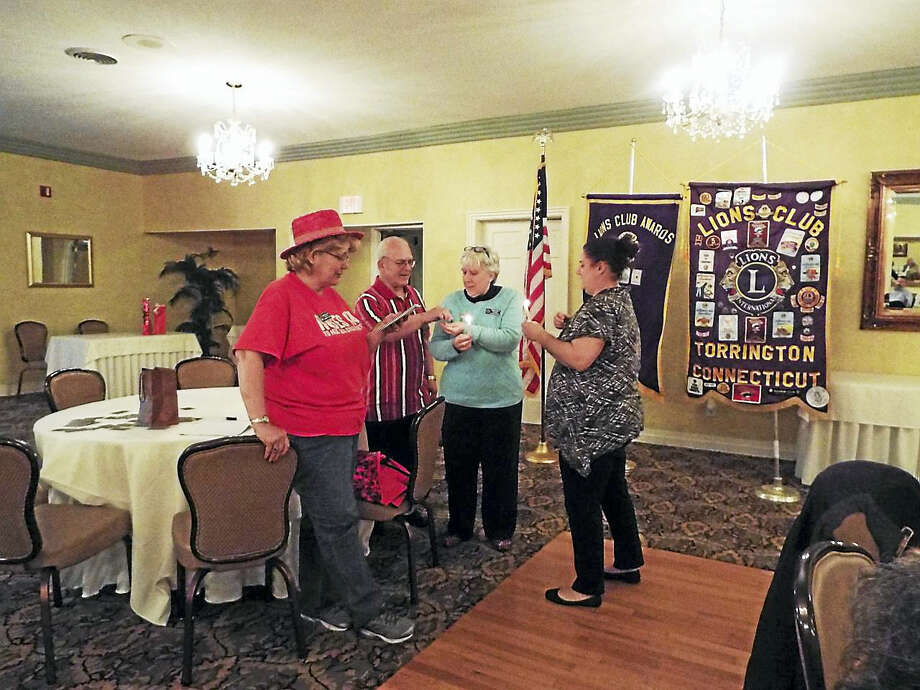 At the recent May meeting of the Torrington Lions Club, new member Bobbi Jo Klug was installed by Past Presidents Kiki Tucker and Phil Dzurnak.  Her sponsor is Doreen Whitney.From left are  Past President Kiki Tucker, PastPresident Phil Dzurnak, Sponsor Doreen Whitney and New Member Bobbi Jo Klug Photo: Digital First Media
