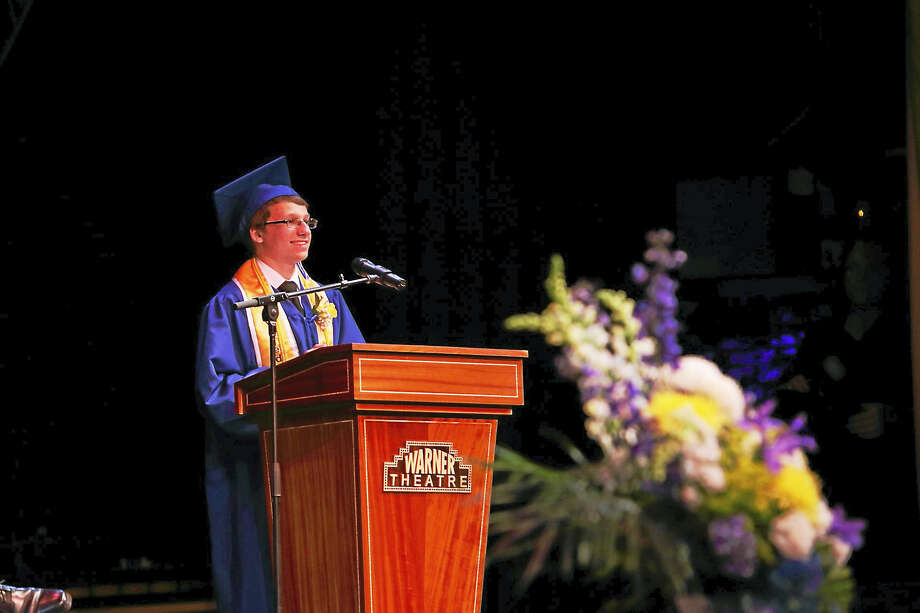 Oliver Wolcott Technical High School Valedictorian Eric Bichet addresses his classmates during graduation on Friday, June 16 at the Warner Theatre in Torrington. During the ceremony, Bichet and Salutatorian Tim Day received citations from state Rep. Michelle Cook and Rep. Brian Ohler for their achievements. Photo: Photographs By Jim Esslinger Of Art Rich Photography