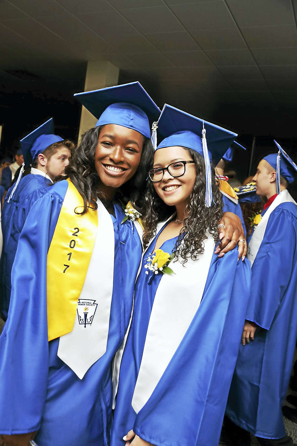 Oliver Wolcott Tech seniors Anya Stephenson, left, and Demarius Dy-Dajnowicz, are all smiles as they prepare to graduate on Friday, June 16. The ceremonies were held at the Warner Theatre in Torrington.