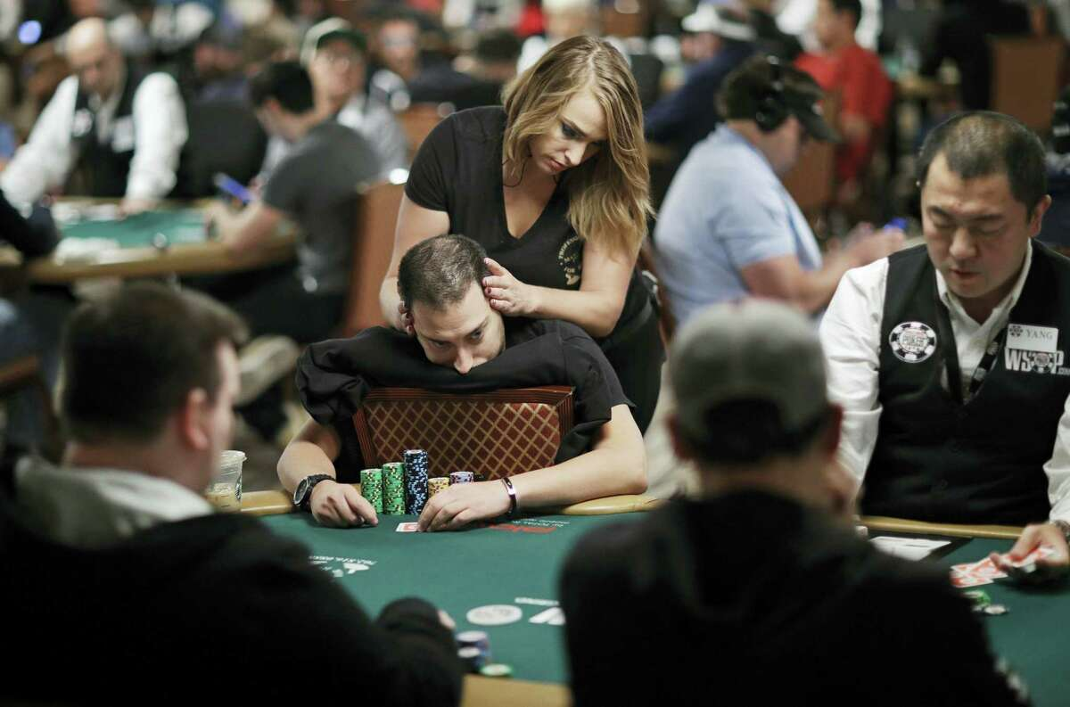 Lana Brey gives a massage to Viliyan Petleshkov during a tournament at the World Series of Poker in Las Vegas.