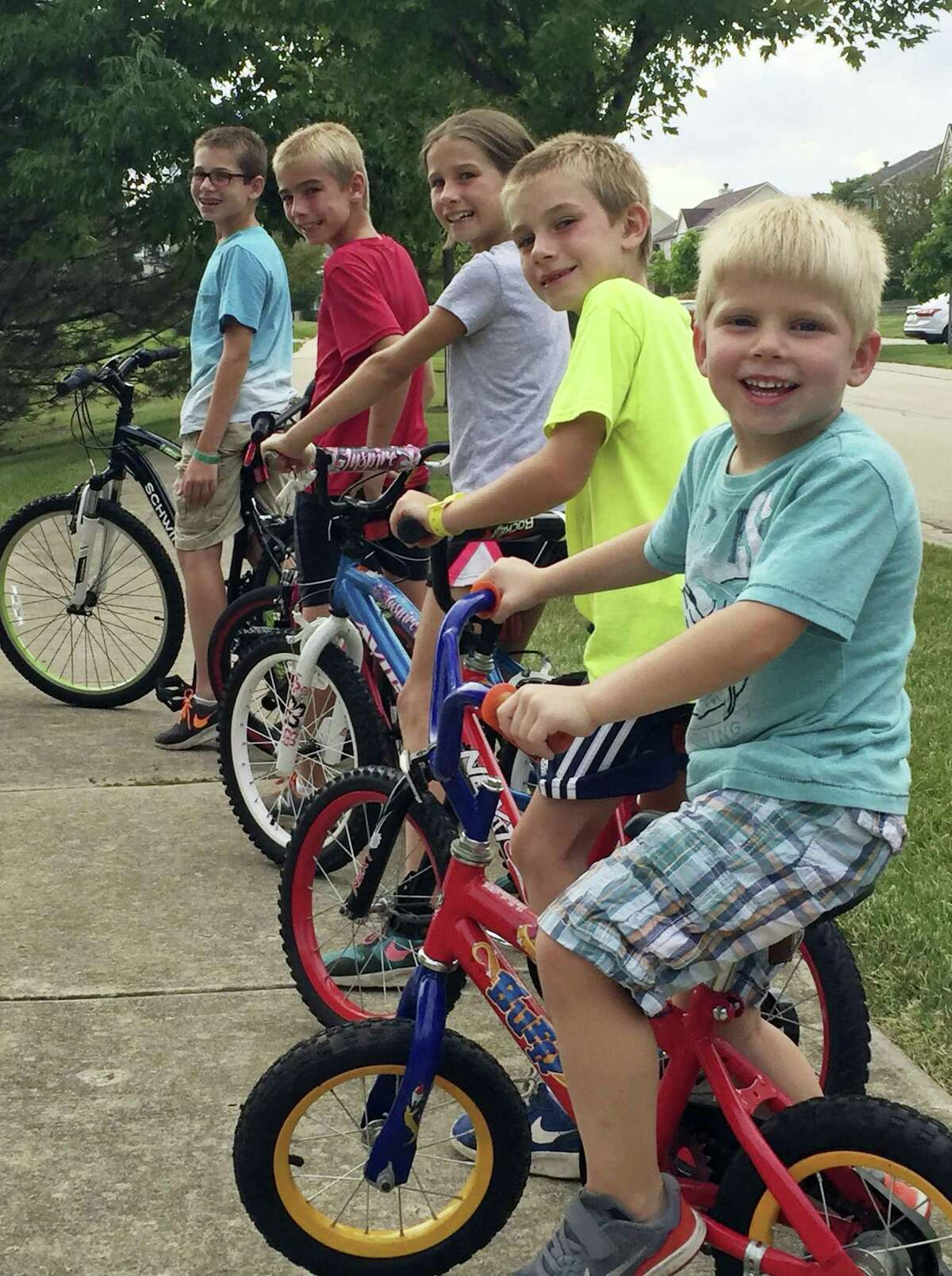 """ADVANCE FOR USE SUNDAY, JUNE 18, 2017 AND THEREAFTER-This July 2017 photo provided by the family shows Kevin Neubert and Jim Gorey's adopted children, Lucas, Zach, Natalie, Jacob, and Derek in Lisle, Ill. """"Some people thought we were crazy, but everyone was supportive of keeping the kids together,"""" Neubert said. (Jim Gorey via AP)"""