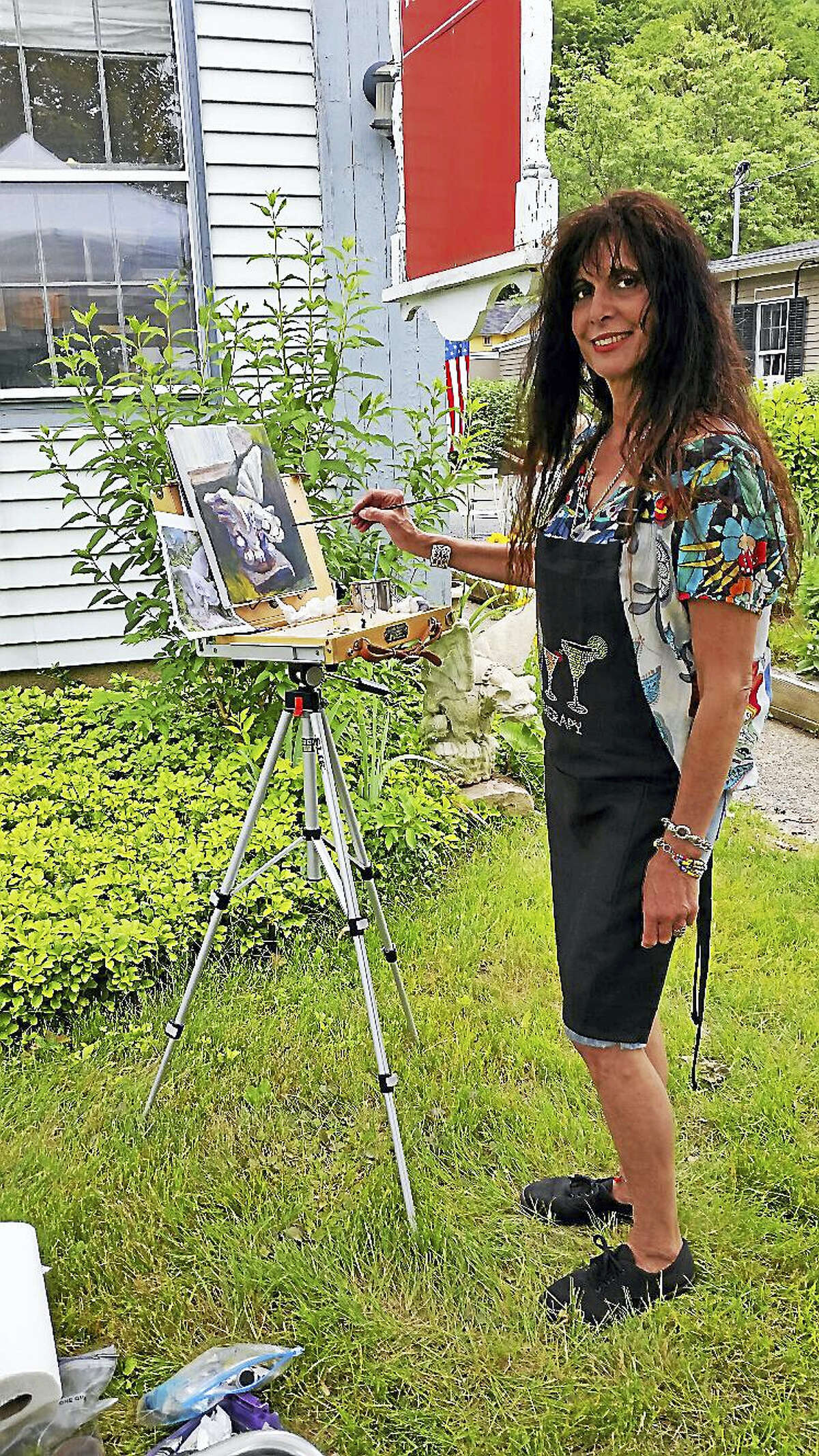 Fine Line Art Gallery board member and artist Mally DeSomma of Waterbury painted a gargoyle as a subject during the gallery's fifth annual Summer Paint-Out on the gallery's front lawn in Woodbury on Saturday.