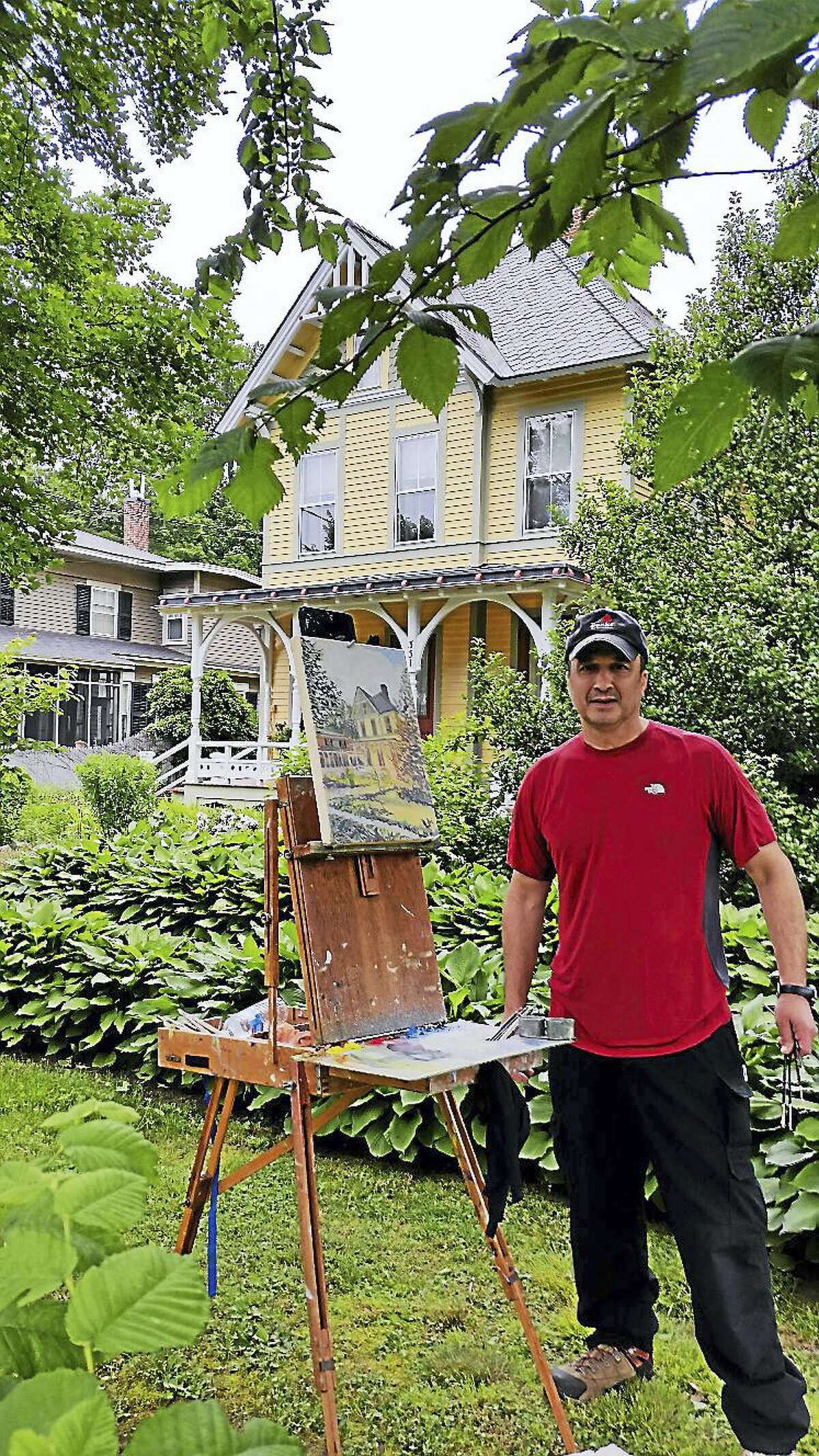 John Forgione, 56, of Easton, painted a neighboring house, an architectural office, as a subject during the Fine Line Art Gallery's Summer Paint-Out.