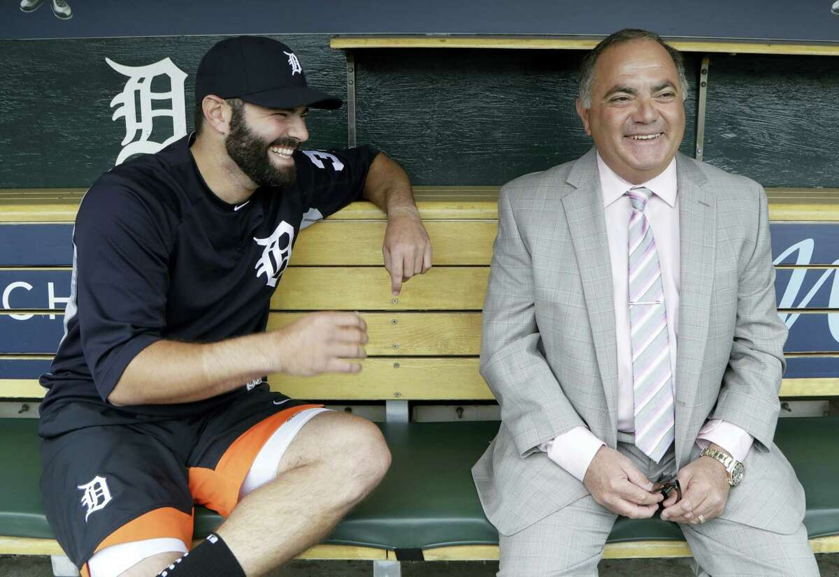 The Tigers' Alex Avila, left, shares a laugh with his father, general manager Al Avila during an interview in Detroit.
