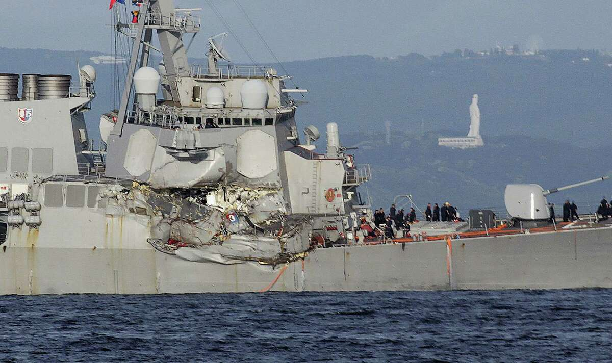 The damaged USS Fitzgerald is seen near the U.S. Naval base in Yokosuka, southwest of Tokyo, after the U.S. destroyer collided with the Philippine-registered container ship ACX Crystal in the waters off the Izu Peninsula Saturday, June 17, 2017. The USS Fitzgerald was back at its home port in Japan after colliding before dawn Saturday with the container ship four times its size, while the coast guard and Japanese and U.S. military searched for seven sailors missing after the crash.