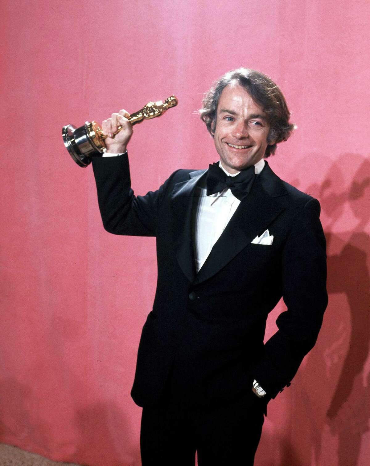 """In this March 28, 1977, file photo, John C. Avildsen shows off the Oscar he won for best director for """"Rocky,"""" at the Academy Awards in Los Angeles. Avildsen, who directed """"Rocky"""" and """"The Karate Kid,"""" the hugely successful underdog fables that went on to become Hollywood franchises, has died at age 81. Avildsen's son Anthony says his father died Friday, June 16, 2017, in Los Angeles from pancreatic cancer."""