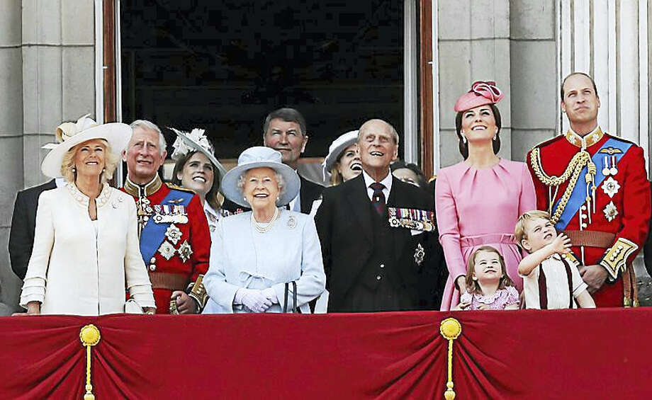 "The royal family watches a ""fly past"" after Trooping the Color ceremony Saturday at Buckingham Palace. Photo: AP Photo — Kirsty Wigglesworth"