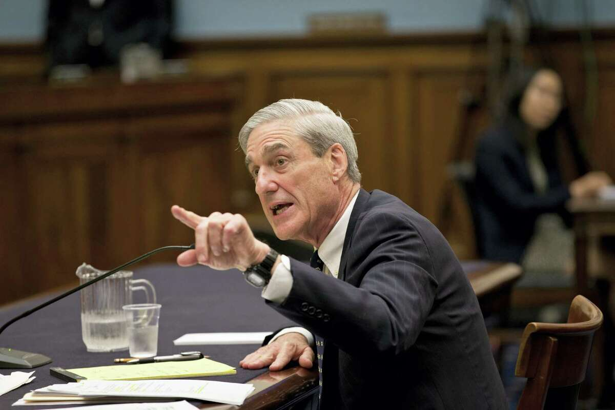 "FILE - In this June 13, 2013 file photo, then-FBI Director Robert Mueller testifies on Capitol Hill in Washington. President Donald Trump's closest allies are attacking the integrity of those involved in the widening probe of Russian interference in the U.S. election, accusing special counsel Mueller of driving a biased investigation. And Trump himself took aim at the senior Justice Department official responsible for appointing Mueller, accusing him on Twitter of leading a ""Witch Hunt."""
