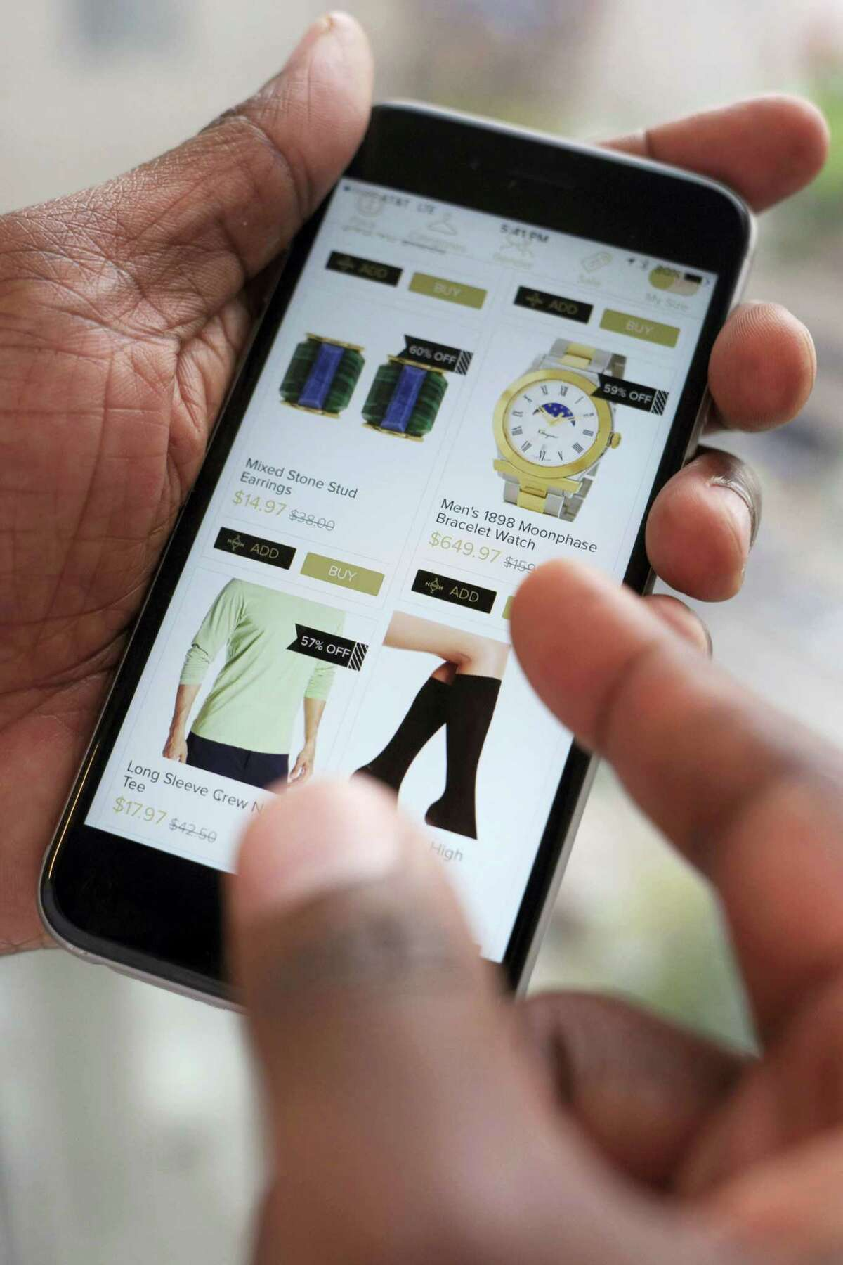 Discounted merchandise displayed on a smartphone using the Hafta Have app, in New York. Shoppers who got addicted to sales and deals during the Great Recession now have more tools to cross-check prices and are finding a surplus of goods online.